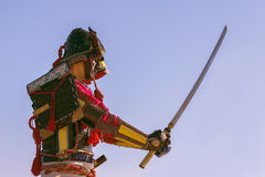 Samurai in ancient armor with a sword Royalty Free Stock Photography