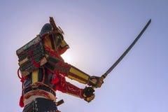 Samurai in ancient armor with a sword. Samurai in ancient armor, with a sword ready to attack close-up Stock Photo