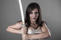 Samurai.Anime stylized brunette with short hair holding a katana Royalty Free Stock Photo