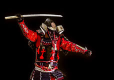 Samurai in armor. Attack the sword. Samurai in ancient armor close-up with a sword attack Royalty Free Stock Image