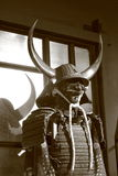 Samurai armor. Elements of Japanese armor - samurai helmet with Buffalo horns and protective mask, cuirass dou with plate shoulder protectors sode stock image