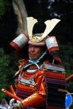 Samurai armor. Japanese man on horseback in o-yoroi samurai retainer type of ceremonial armor with horns on helmet Royalty Free Stock Photos