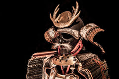 Samurai body armor. Isolated on black background Stock Photos