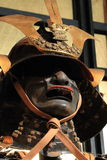 Samurai. Elements of Japanese armor - samurai helmet with front embellishment maedate and protective mask mempo Royalty Free Stock Photos