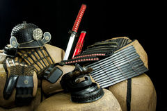 Samurai Gear. Collection of Samurai knives and protective gear on large rocks Royalty Free Stock Photos