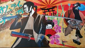 Samurai. & Geisha girl, a mural in a restaurant wall Royalty Free Stock Photos