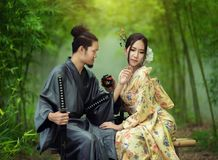 Samurai and geisha royalty free stock photo