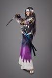Samurai giapponese con la spada di katana Fotografie Stock