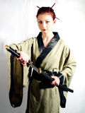 Samurai girl #5. Girl wearing chimono with samurai sword stock image