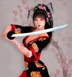 Samurai girl with sword Royalty Free Stock Photography