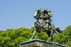 Samurai Kusunoki Masashige statue, Tokyo. The great samurai Kusunoki Masashige statue with copy space for text. It located at East Garden outside Tokyo Imperial Stock Images