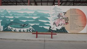 Samurai mural Bishop Arts District, Dallas, Texas. Pictured is a part of a wall mural by artist Derek Nemunaitis in the Bishop Arts District, Dallas, Texas. The royalty free stock photography
