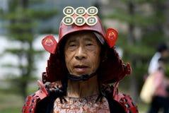 Samurai, Osaka, Japan. Elderly man wears a fake samurai helmet in Osaka Royalty Free Stock Photos