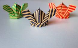 Samurai`s hats origami. Three samurai`s hats `Kabuto` craft paper origami Royalty Free Stock Photography