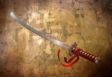 Samurai sword. A samurai sword on vintage background. In kanji alphabet is wroten Samurai on the background and Dark shadows on the blade Stock Images