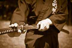 Samurai with sword. Samurai showing kata with sword Stock Photo