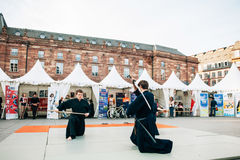 Samurai sword public demonstration by two men Stock Images