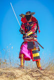 Samurai with sword on the sand. Royalty Free Stock Photos