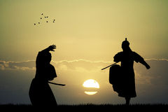 Samurai with swords at sunset. Illustration of Samurai at sunset Royalty Free Stock Photography