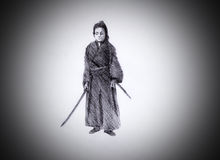 Samurai with two swords Royalty Free Stock Image