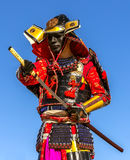 Samurai warrior armor pulls the sword attack. Clouse-up Royalty Free Stock Photo