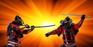 Samurai warrior with sword at sunset. Samurai in ancient armor, with a sword ready to attack at sunset Stock Photos
