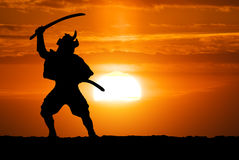 Samurajer på solnedgång Royaltyfria Bilder