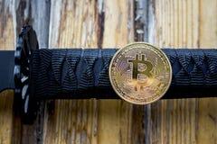 Samurajsvärd och Bitcoin Arkivbilder