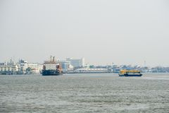Commercial ships sail pass each other in Chao Phraya river stock photos
