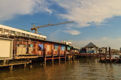 Samut Prakan, Thailand - March 25, 2017: Local ferry pier across. Chao Phraya River at Amphur Muang district, Samut Prakarn, Thailand Royalty Free Stock Photos