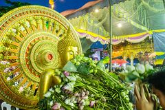 SAMUT PRAKAN,THAILAND-OCTOBER 18, 2013:The Lotus Giving Festival. (Rap Bua) in Samut Prakan,Thailand. Devotees throw lotus flowers to boat procession that carry Stock Photography