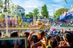 SAMUT PRAKAN,THAILAND-OCTOBER 18, 2013:The Lotus Giving Festival. (Rap Bua) in Samut Prakan,Thailand. Devotees throw lotus flowers to boat procession that carry stock image