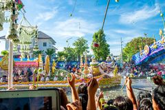 SAMUT PRAKAN,THAILAND-OCTOBER 18, 2013:The Lotus Giving Festival. (Rap Bua) in Samut Prakan,Thailand. Devotees throw lotus flowers to boat procession that carry royalty free stock images