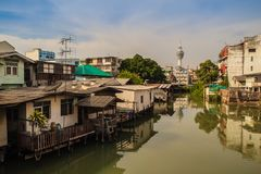 Samut Prakarn observation tower with canal and village in foregr Royalty Free Stock Images