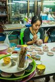 Woman artist painting ceramic pottery in factory house. Samut Sakhon, Thailand - January 21, 2018: Woman artist painting ceramic pottery in factory house where Stock Images