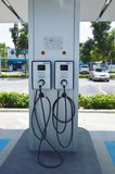 Electric vehicle charger in gas station for supporting electrical car in future royalty free stock image