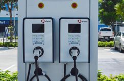 Electric vehicle charger in gas station for supporting electrical car in future stock images
