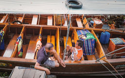 SAMUT SAKORN, THAILAND - MARCH 12: Young male waiting for guest. On long tail boat on the Mea klong river in amphawa floting market,Samut sakorn -  Thailand on Stock Images