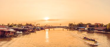 Samut Songkhram , Thailand - April 14, 2018: River cruise boats transporting people on the Mae Klong River. This is a very popular tourist attraction in the stock photos
