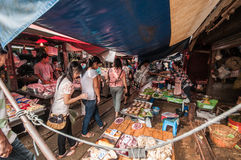 Samut Songkhram, Thailand: Railway Market. As a Thai Railways train approaches all the vendors at the famed Mae Klong Railway Market in Samut Songkhram, Thailand Royalty Free Stock Images