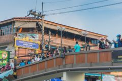 SAMUT SONGKRAM THAILAND - APRIL 21 : Unidentified tourists eat f. Ood and boat trip around in Amphawa floating market in evening on april 21,2018 at Amphawa lake royalty free stock photo