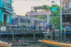 SAMUT SONGKRAM THAILAND - APRIL 21 : Unidentified tourists eat f. Ood and boat trip around in Amphawa floating market in evening on april 21,2018 at Amphawa lake stock image