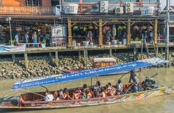 SAMUT SONGKRAM THAILAND - APRIL 21 : Unidentified tourists eat f. Ood and boat trip around in Amphawa floating market in evening on april 21,2018 at Amphawa lake royalty free stock photography
