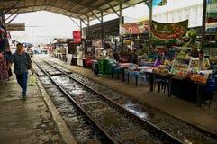 View to the market at the Maeklong railroad train station in Samut Songkram, Thailand. Stock Photos