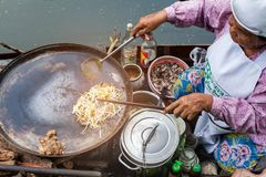 Samut songkram, Thailand - November 11, 2017: cooking food fried - delicious Thai food at Tha Kha floating market royalty free stock image
