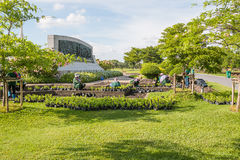 SAMUTPRAKAN  THAILAND - MAY 15: The gardener plants flowers on M. Ay 15, 2017 in public park, Samutprakan province, Thailand Royalty Free Stock Image