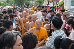 Samutprakarn, THAILAND - OCT 09 : Buddhist monks are given food offering from people for End of Buddhist Lent Day. on October 09, Stock Images