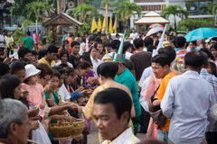 Samutprakarn, THAILAND - OCT 09 : Buddhist monks are given food offering from people for End of Buddhist Lent Day. on October 09, Stock Image