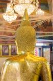 Samutprakarn, thailand October 19, 2016: Peop. Le cover with gold leaf on Buddha statue at wat bang phli Yai on October 19, 2016 in smutprakarn, Thailand Royalty Free Stock Photography
