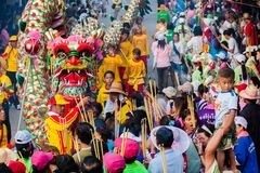 SAMUTSAKHON, THAILAND :  MAY 31 : Golden dragon and Lion doing r. Itual at worship of people in samutsakhon pillar shrine parade, 31 May 2009, Thailand Stock Photo
